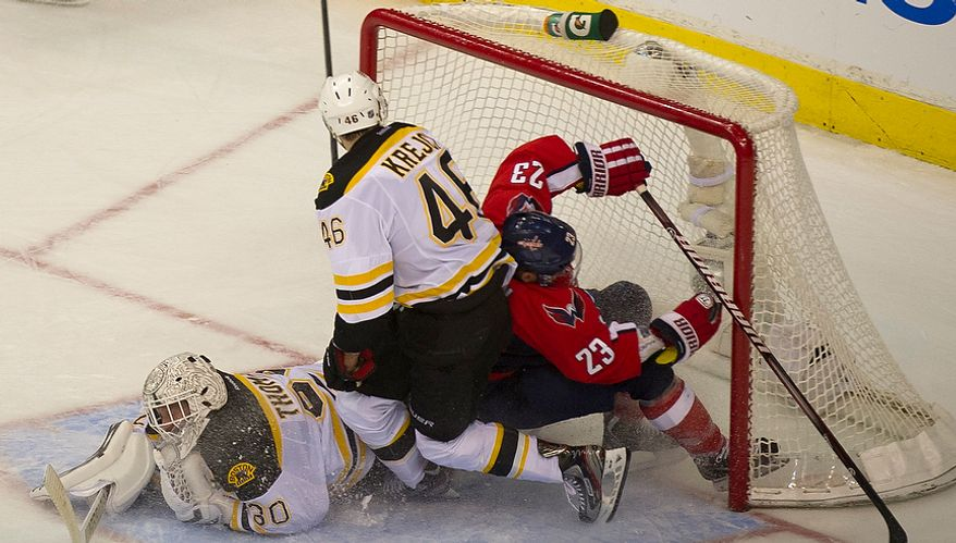 Keith Aucoin (23) of the Washington Capitals collides into the net against David Krejci (46) and goalie Tim Thomas (30) of the Boston Bruins in the second period of the Eastern Conference Quarterfinals Game 6 at the Verizon Center in Washington, D.C., Sunday, April 22, 2012. (Rod Lamkey Jr/The Washington Times)