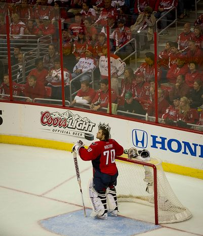 Washington Capitals goalie Braden Holtby (70) looks up to the score board after giving up a goal to the Boston Bruins in the third period during the Eastern Conference Quarterfinals Game 6 at the Verizon Center in Washington, D.C., Sunday, April 22, 2012. The Bruins defeated the Capitals 4-3 in overtime. (Rod Lamkey Jr/The Washington Times)