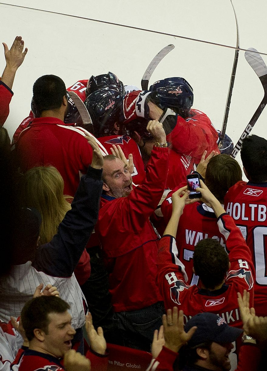 The crowd and the Washington Capitals celebrate a goal by captain Alex Ovechkin (8) against the Boston Bruins in the third period during the Eastern Conference Quarterfinals Game 6 at the Verizon Center in Washington, D.C., Sunday, April 22, 2012. The Bruins defeated the Capitals 4-3 in overtime. (Rod Lamkey Jr/The Washington Times)