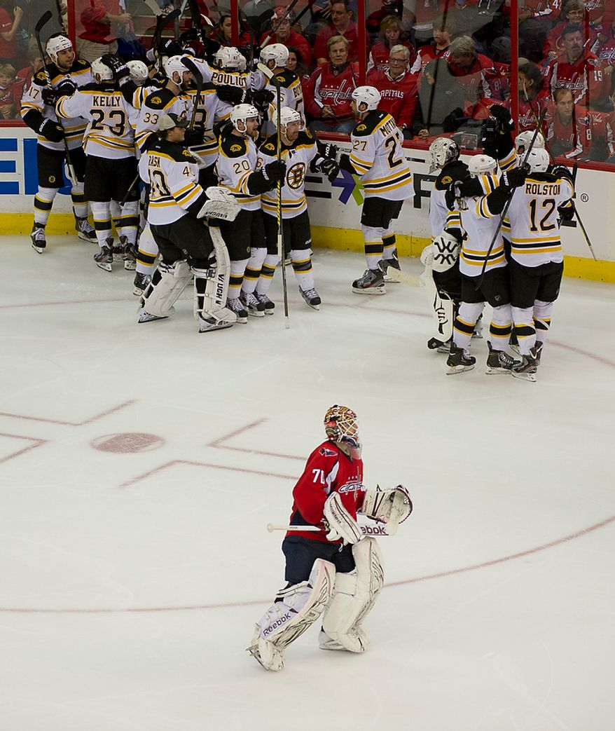Washington Capitals goalie Braden Holtby (70) leaves the ice as the Boston Bruins celebrate Tyler Seguin's winning goal in overtime during the Eastern Conference Quarterfinals Game 6 at the Verizon Center in Washington, D.C., Sunday, April 22, 2012. The Bruins defeated the Capitals 4-3, sending he series back to Boston for a Game 7. (Rod Lamkey Jr/The Washington Times)