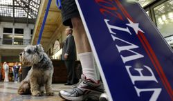 James Kirchhausen and his dog Major wait April 20, 2012, for Republican presidential candidate and former House Speaker Newt Gingrich to arrive at a campaign stop in Buffalo, N.Y. (Associated Press)