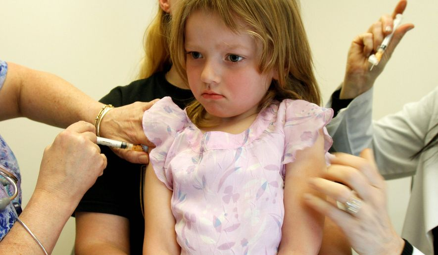 ** FILE ** In this April 22, 2012, file photo, Holly Ann Haley, 4, gets vaccinations at the doctor's office in Berlin, Vt., although the state continues to be embroiled in a debate about continuing to allowing parents to have their children skip the immunizations required for most to attend school. (Associated Press)