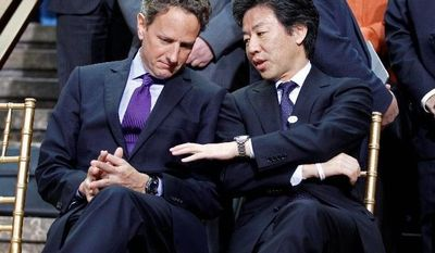 U.S. Treasury Secretary Timothy F. Geithner and Japan's Finance Minister Jun Azumi confer at the IMF/World Bank spring meetings in Washington on Saturday. The U.S. has not pledged more money for the IMF's fund used for loans to troubled nations. (Associated Press)