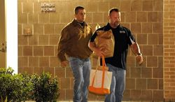 George Zimmerman (left) exits the John E. Polk Correctional Facility, accompanied by a bondsman, on Sunday in Sanford, Fla. Mr. Zimmerman posted bail on a second-degree murder charge in the February shooting death of 17-year-old Trayvon Martin, but he was fitted with a monitoring device when he was released. (Associated Press)