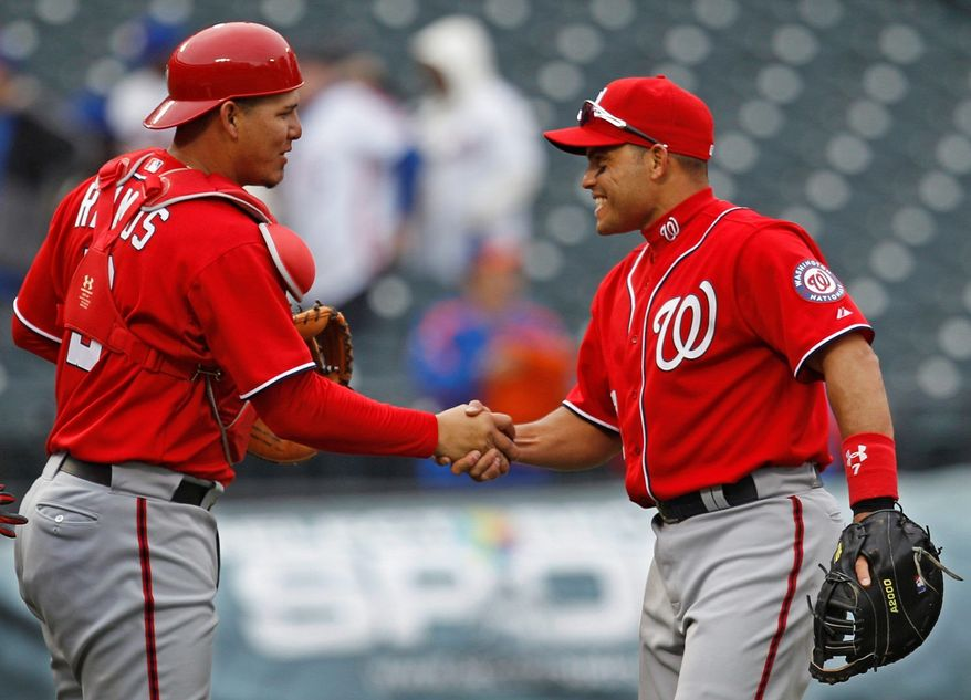 Nationals catcher Wilson Ramos (left) grew up idolizing Ivan Rodriguez. Ramos, who was acquired from Minnesota in July 2010, quickly took to learning from the 14-time All-Star. Rodriguez announced his retirement Monday, ending his 21-year career. (Associated Press)