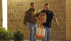 George Zimmerman (left) leaves the John E. Polk Correctional Facility with an unidentified man on April 22, 2012, in Sanford, Fla. Mr. Zimmerman posted bail on a $150,000 bond on a second-degree-murder charge in the February shooting death of 17 year-old Trayvon Martin. (Associated Press)