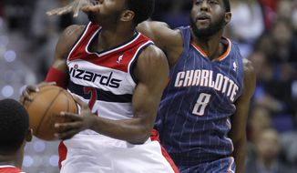 Washington Wizards guard John Wall (2) drives to the basket against Charlotte Bobcats forward D.J. White (8) during the first half of an NBA game Monday, April 23, 2012, in Washington. (AP Photo/Evan Vucci)