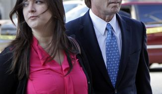 Former presidential candidate and U.S. Sen. John Edwards (right) arrives April 23, 2012, outside federal court with his daughter Cate in Greensboro, N.C., for his trial on charges of violating federal campaign finance laws. (Associated Press)