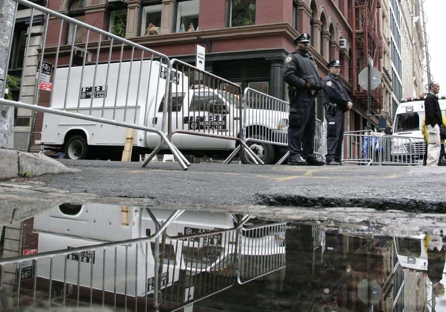 New York City police stand at a barricade on Monday, April 23, 2012, in front of a building in the SoHo neighborhood of Manhattan where authorities were digging up the basement in connection with the disappearance 33 years ago of 6-year-old Etan Patz. (AP Photo/Peter Morgan)
