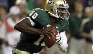 ** FILE ** In this Nov. 19, 2011, photo, Baylor quarterback Robert Griffin III looks to pass in the first half of an NCAA college football game against Oklahoma in Waco, Texas. Griffin is a top prospect in the upcoming NFL football draft. (AP Photo/Tony Gutierrez, File)