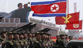 North Korean soldiers take part in a mass military parade on Kim Il-sung Square in Pyongyang, North Korea, on Sunday, April 15, 2012, to celebrate the centenary of the birth of Kim, the country's founder. (AP Photo/Ng Han Guan)