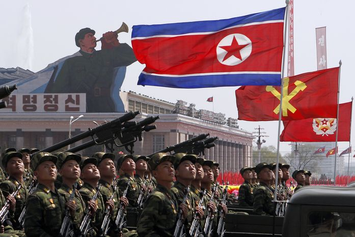 North Korean soldiers take part in a mass military parade on Kim Il-sung Square in Pyongyang, North Korea, on Sunday, April 15, 2012, to celebrate the centenary of the birth of Kim, the country's fou