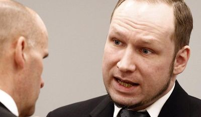 Defendant Anders Behring Breivik (right) talks with defense lawyer Geir Lippestad in a courtroom in Oslo on Monday, April 23, 2012. (AP Photo/Lise Aserud, POOL)