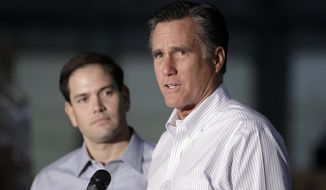 GOP presidential candidate Mitt Romney (right) talks to reporters on Monday, April 23, 2012, as he is joined by Sen. Marco Rubio, Florida Republican, during a news conference before a town-hall-style meeting in Aston, Pa. (Associated Press)