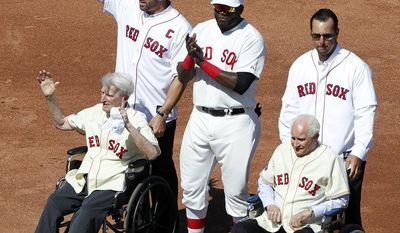 Former Boston Red Sox catcher Jason Varitek, top left, stands with current designated hitter David Ortiz, top center, former pitcher Tim Wakefield, top right, and former players Bobby Doerr, seated right, and Johnny Pesky, seated left, on the field during ceremonies to celebrate the 100th anniversary of a regular season baseball game at Fenway Park before the game between the New York Yankees and the Red Sox in Boston on Friday, April 20, 2012. (AP Photo/Michael Dwyer)
