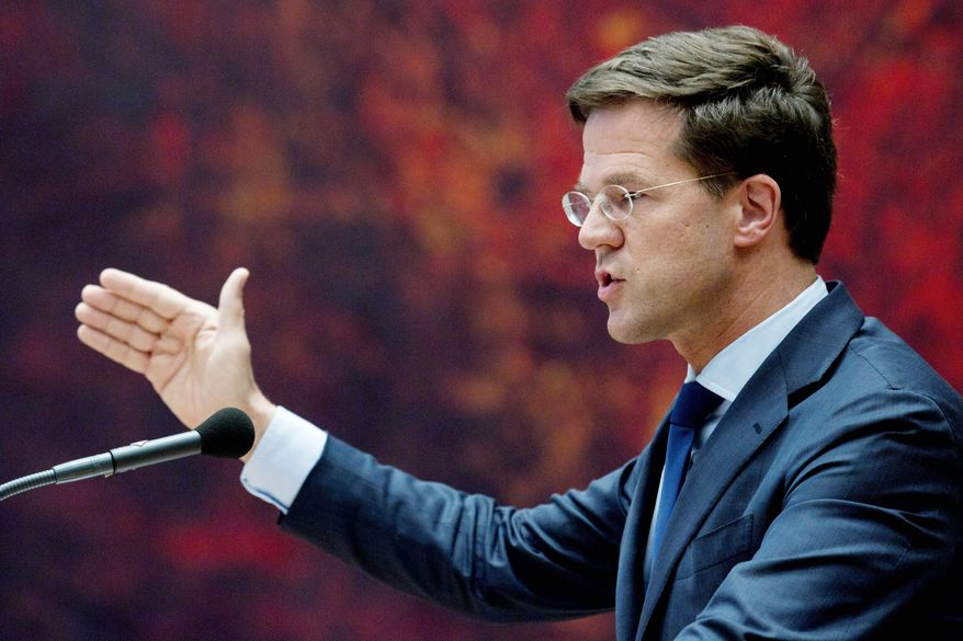 """I stand here in the hope that parties in this chamber are prepared ... to do what is necessary to pull the Netherlands through these difficult economic times,"" caretaker prime minister Mark Rutte tells Parliament on Tuesday. (Associated Press)"