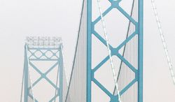 The Ambassador Bridge, which connects Detroit to Windsor, Ontario, is privately owned. A second bridge has been proposed to ease mounting traffic flow. (Associated Press)