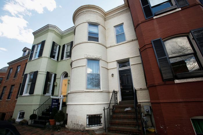 This row house in Georgetown was home to Albrecht Muth, 47, and Viola Drath, 91. Mr. Muth, charged with killing his socialite wife, faces a competency hearing Wednesday. (Associated Press)