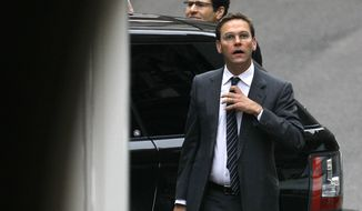 Media scion James Murdoch arrives at the Levenson media inquiry to give evidence at the High Court in London on Tuesday, April 24, 2012. (AP Photo/Alastair Grant)