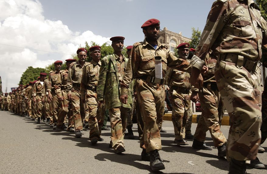 Yemeni army defectors march in Sanaa, Yemen, on Monday, April 23, 2012, to support protesters' demands for independence of the judicial system from government control. (AP Photo/Hani Mohammed)