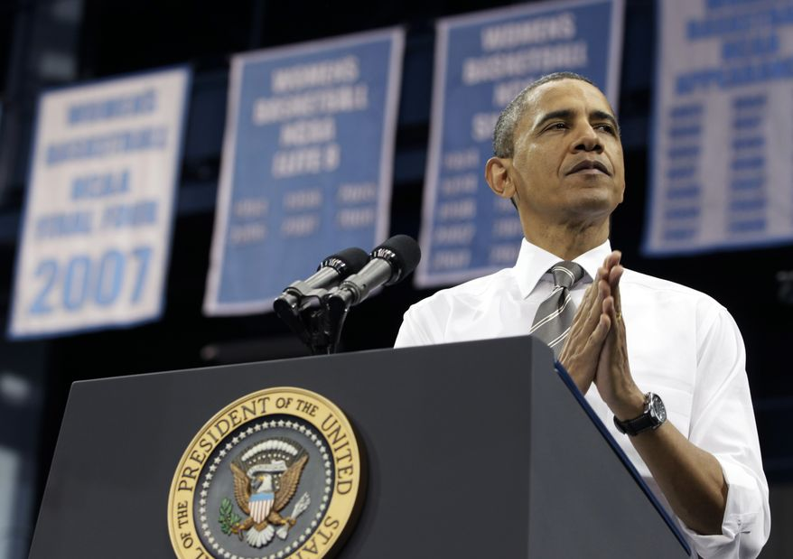 President Obama pauses as he speaks April 24, 2012, at the University of North Carolina at Chapel Hill. (Associated Press)