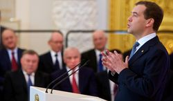 Russian President Dmitry Medvedev (right) addresses the State Council in the Kremlin in Moscow on Tuesday, April 24, 2012. (AP Photo/Alexander Zemlianichenko)
