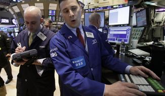 ** FILE ** Trader Damian Bagarozza (left) and specialist Joseph Mastrolia work on the floor of the New York Stock Exchange on Monday, April 16, 2012. (AP Photo/Richard Drew)