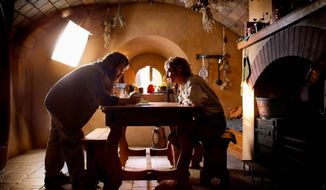 """Peter Jackson consults with Martin Freeman on the set of """"The Hobbit, An Unexpected Journey."""" Introducing footage from the film that uses 48 frames per second, he warned that it would take time to adjust to the new approach. (Warner Bros. Pictures)"""