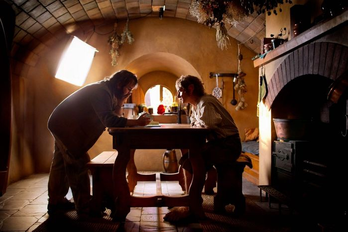 """Peter Jackson consults with Martin Freeman on the set of """"The Hobbit, An Unexpected Journey."""" Introducing footage from the film that uses 48 frames per second, he warned that it would take ti"""
