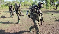 Ugandan soldiers trying  to find the fugitive warlord Joseph Kony have had more contact in the jungle with poachers  and natural predators so  far. A soldier crossing a river in the Central African Republic last week was drowned and mauled by a crocodile. (Associated Press)