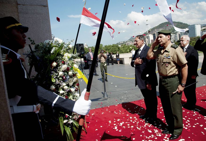 Defense Secretary Leon E. Panetta (third from right) and a Brazilian general pay their respects during a wreath-laying ceremony at the Tomb of the Unknown Soldier at the National Monument for the Casualties of World War II in Rio de Janeiro on Wednesday. (Associated Press)