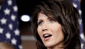 """Violence knows no bounds,"" says Rep. Kristi L. Noem, South Dakota Republican, during a news briefing Wednesday with 11 other GOP women lawmakers. (Associated Press)"