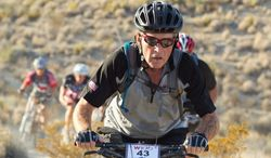 "Former President George W. Bush, shown during the 2011 ride, will host a ""Warrior 100K"" mountain bike ride this week accompanied by disabled veterans. (George W. Bush Presidential Center)"