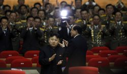 North Korean leader Kim Jong-un applauds on Wednesday, April 25, 2012, as he walks ahead of Kim Yong-nam, president of the Presidium of the Supreme People's Assembly, after attending a concert in Pyongyang, North Korea, to mark the 80th anniversary of the founding of the North Korean army. (Associated Press)