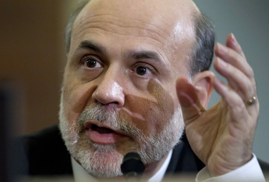 ** FILE ** In a Feb. 2, 2012, file photo Federal Reserve Chairman Ben Bernanke testifies on Capitol Hill in Washington before the House Budget Committee. The Federal Reserve will have plenty to say about the economy Wednesday, April 25, 2012, when its two-day policy meeting ends. (AP Photo/Carolyn Kaster/file)