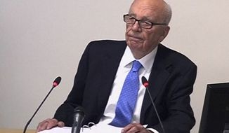 ** FILE ** News Corp. Chairman Rupert Murdoch appears before Lord Justice Brian Leveson's inquiry into U.K media ethics on Wednesday, April 25, 2012, in London. (AP Photo/Pool)