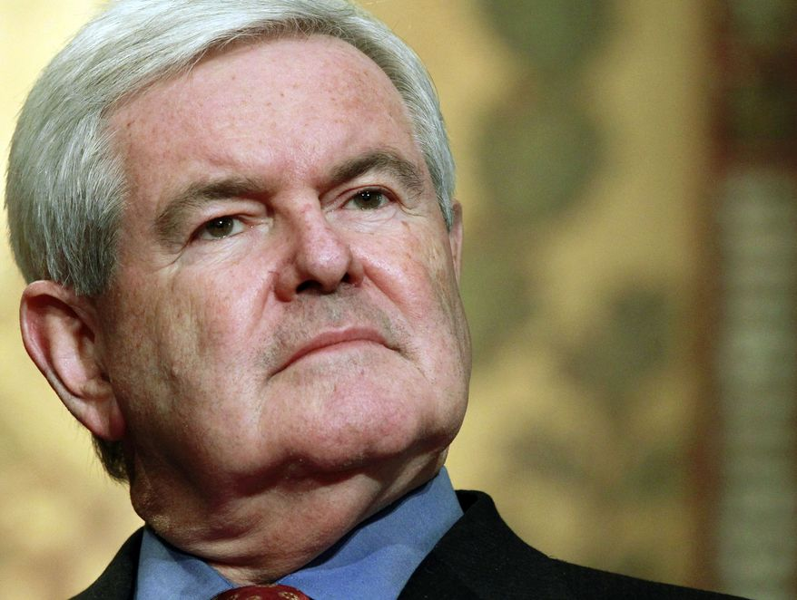 """** FILE ** In this March 28, 2012, file photo Republican presidential candidate, former House Speaker Newt Gingrich, waits to speak at Georgetown University in Washington. Gingrich is today millions in debt and describing Mitt Romney as """"far and away the most likely"""" GOP nominee. (AP Photo/Haraz N. Ghanbari, File)"""