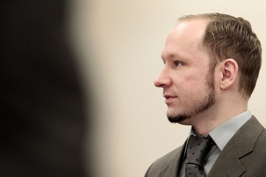 Anders Behring Breivik stands in a courtroom in Oslo in Wednesday, April 25, 2012, during his trial for killing 77 people in a bombing-and-shooting rampage last summer. (AP Photo/Hakon Mosvold Larsen, Pool)