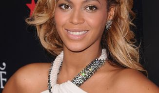 **FILE** Singer Beyonce Knowles makes an appearance at Macy's Herald Square on Sept. 22, 2011, to promote her new fragrance 'Pulse' in New York. (Associated Press)
