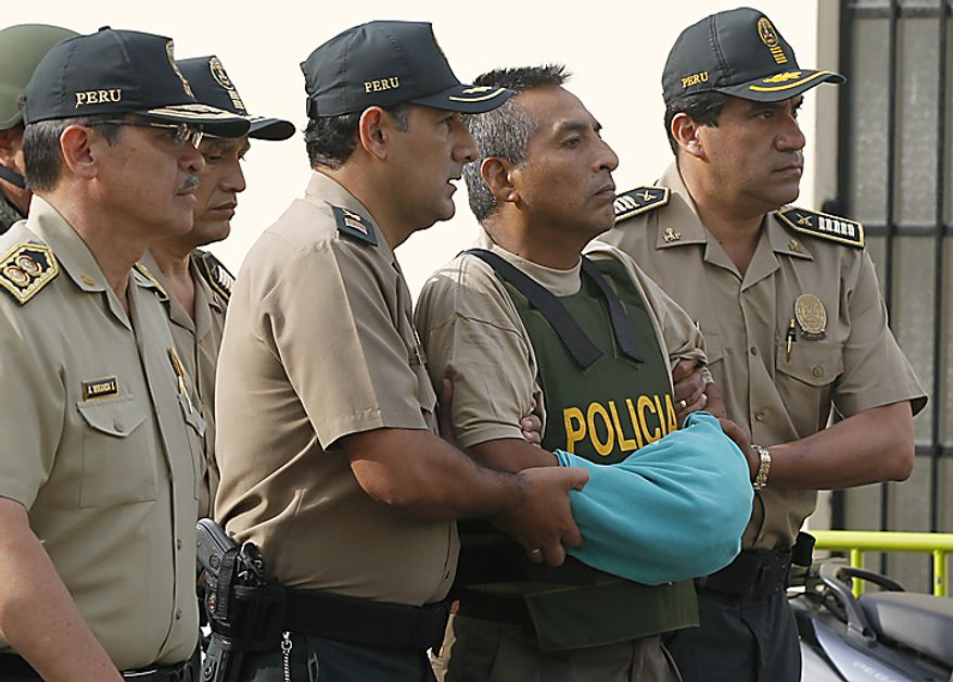 "** FILE ** A top leader of the once-powerful Shining Path rebel group, Comrade Artemio, whose given name is Florindo ""Juan"" Flores, center, is escorted by police officers outside a police hospital in Lima, Peru, Wednesday Feb. 22, 2012. Flores was captured by Peruvian troops on Sunday, Feb. 12, in the remote coca-growing Upper Huallaga Valley of central Peru. (AP Photo/Martin Mejia)"