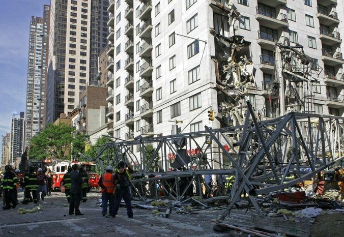 **FILE** Rescue crews work at the scene of a May 2008 crane collapse on New York's Upper East Side. (Associated Press)