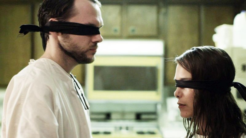 "Chris Denham and Nicole Vicius co-star in ""Sound of my Voice,"" a sci-fi film involving infiltrating a cult. (Fox Searchlight)"