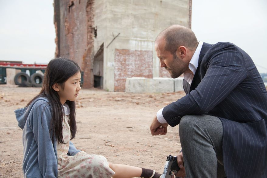 "Jason Statham and Catherine Chan star in the blue-collar action flick ""Safe,"" which is driven a light plot and heavy dose of action sequences. (Lionsgate via Associated Press)"