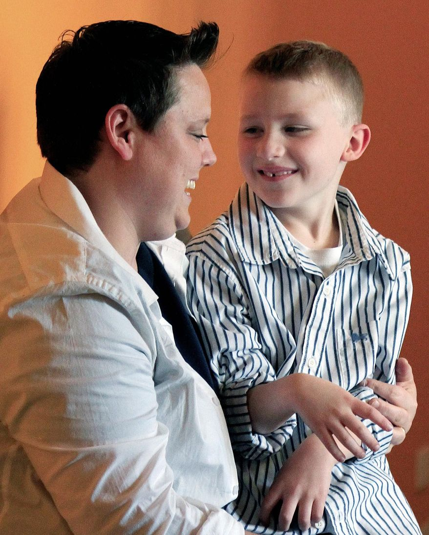 Jennifer Tyrrell, of Bridgeport, Ohio, seen here with son Cruz Burns, 7, was removed as leader of his Scout troop because of her sexual orientation. (Associated Press)