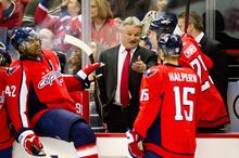 Capitals right wing Joel Ward (42) listened to strategy from Dale Hunter during Hunter's first game as coach Nov. 29. Ward, signed to a four-year, $12 million free agent contract, finished the regular season with six goals and 12 assists. (Andrew Harnik/The Washington Times)