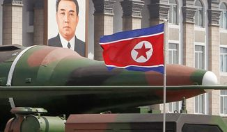 What appears to be a new missile is transported during a military parade April 15 in Pyongyang to celebrate the centennial of North Korea's founder, Kim Il-sung. Analysts say the missiles are fakes made to hide North Korea's lack of progress on ICBMs. (Associated Press)