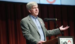 The Michigan law that lets Gov. Rick Snyder name emergency managers to help fiscally troubled cities and school systems was the target of a repeal effort that ended in a deadlocked vote to put it on the ballot. (Associated Press)