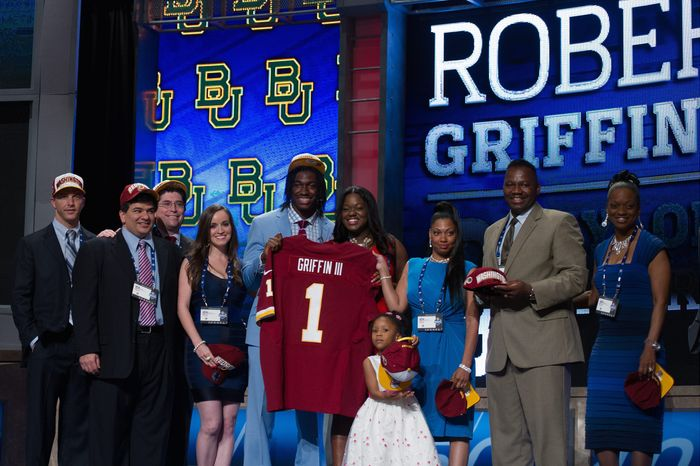 Quarterback Robert Griffin III poses on stage with his family after being selected by the Redskins with the second overall pick in the NFL Draft on Thursday night. Griffin won the Heisman Trophy in his senior season at Baylor. (Andrew Harnik/The Washington Times)