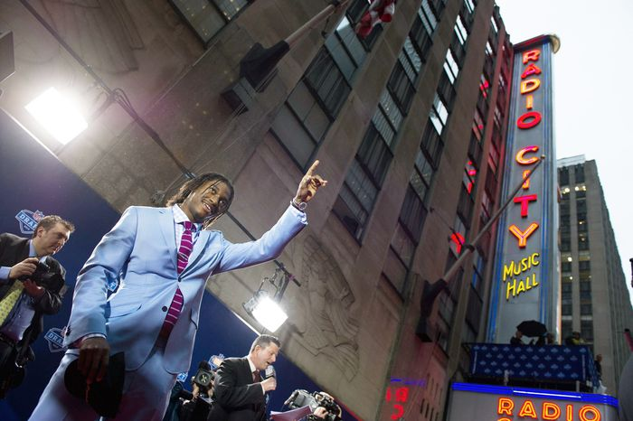 Photographs by ANDREW HARNIK/THE WASHINGTON TIMES Former Baylor quarterback Robert Griffin III arrives on the red carpet for the NFL Draft at Radio City Music Hall in New York. Griffin, last season's Heisman Trophy winner, was selected second overall by the Redskins.