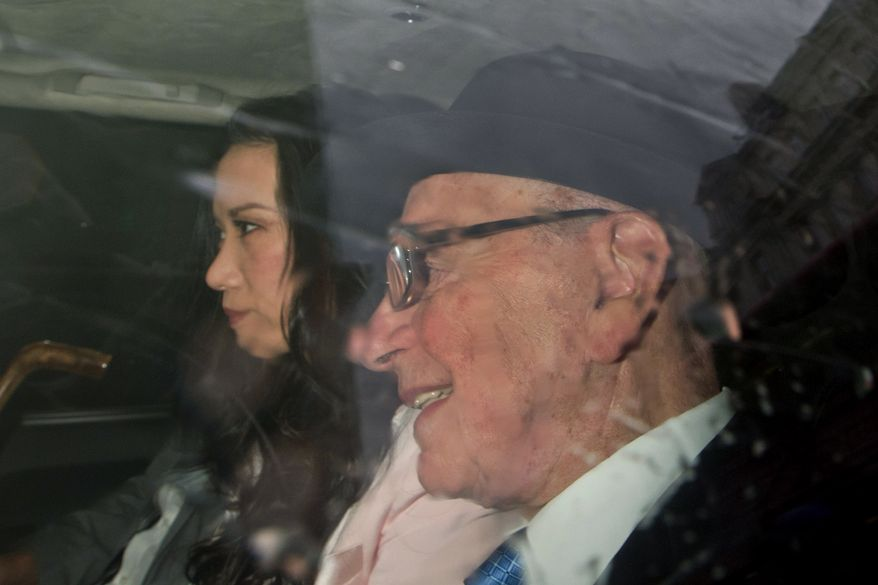 News Corp. head Rupert Murdoch and his wife, Wendi Deng, arrive at the High Court in London on Thursday, April 26, 2012, before Mr. Murdoch's appearance before the Leveson panel, which is investigating the British phone-hacking scandal. (AP Photo/Sang Tan)